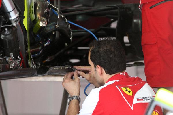 Ferrari mechanic works on Ferrari F138. Formula One World Championship, Rd4, Bahrain Grand Prix Preparations, Bahrain International Circuit, Sakhir, Bahrain, Thursday 18 April 2013.