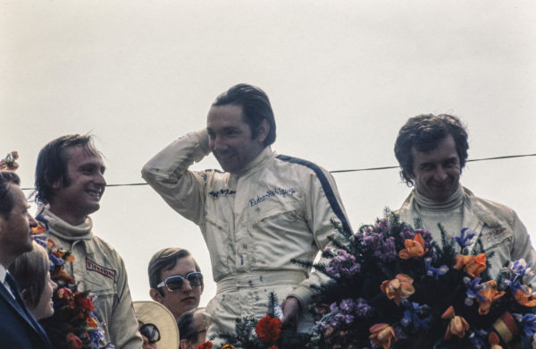 Pedro Rodriguez celebrates victory on the podium with Chris Amon, 2nd position and Jean-Pierre Beltoise, 3rd position.