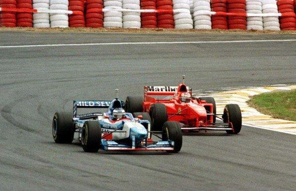 1997 Brazilian Grand Prix.Interlagos, Sao Paulo, Brazil.28-30 March 1997.Gerhard Berger (Benetton B197 Renault) passes Michael Schumacher (Ferrari F310B) to finish in 2nd position.World Copyright - LAT Photographic