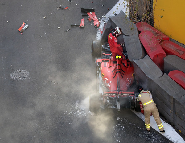 Charles Leclerc, Ferrari SF90, climbs out of his damaged car after his crash in Q2