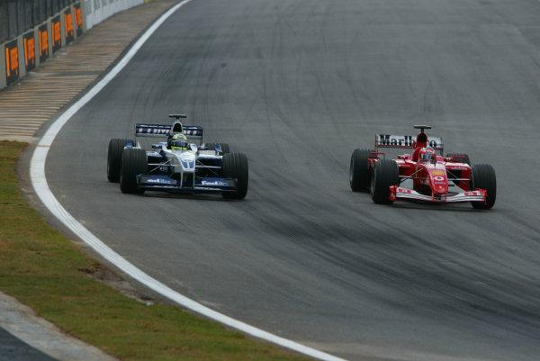 2002 Brazilian Grand Prix - Sunday RaceInterlagos, Sao Paulo. 31st March 2002Rubens Barrichello (Ferrari F2001) passes Ralf Schumacher (Williams FW24 BMW) for 2nd position.World Copyright - LAT Photographicref: Digital File Only