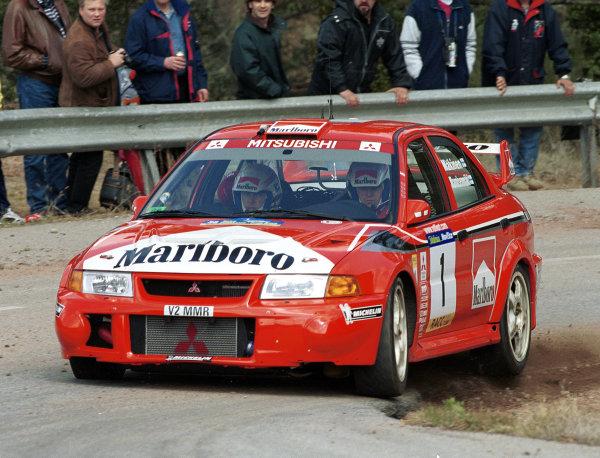 Tommi Makinen in action in his Mitsubishi Lancer Evo 6.Catalunya Rally 2000.Photo:McKlein/LAT