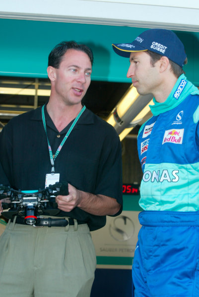 2002 American Grand Prix.Indianapolis, Indiana, USA. 27-29 September 2002.Heinz-Harald Frentzen (Sauber Petronas) with Russ Wicks, the World Water Speed Record holder (for a propeller driven boat).World Copyright - LAT Photographicref: Digital File Only