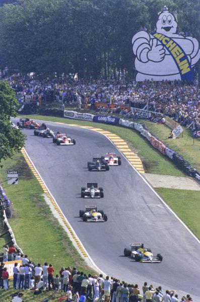 Nelson Piquet, Williams FW11 Honda, leads Nigel Mansell, Williams FW11 Honda, Gerhard Berger, Benetton B186 BMW, Ayrton Senna, Lotus 98T Renault, Keke Rosberg, McLaren MP4-2C TAG, Alain Prost, McLaren MP4-2C TAG, and Teo Fabi, Benetton B186 BMW.