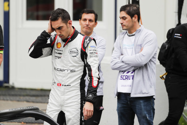 Sébastien Buemi (CHE), Nissan e.Dams, looks over his car in the pit lane