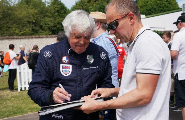 Brian Redman signs autographs.