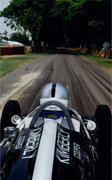 Goodwood House, East Sussex, England. 18th - 20th June 1999. Sir Jack Brabham waits in the Cooper T54 Indycar at the start of the hill.World Copyright - LAT Photographic. Exhibition ref: a029