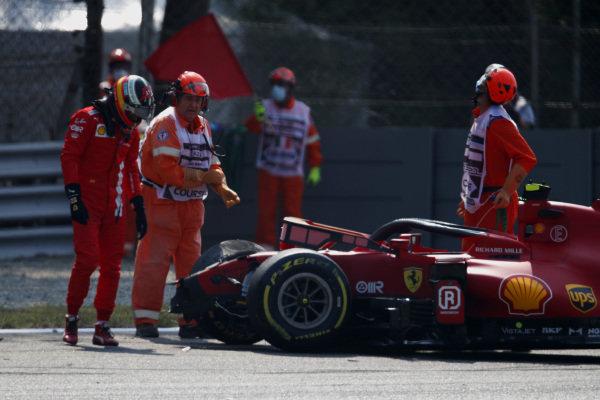 Carlos Sainz, Ferrari SF21, inspects the damage to his car after crashing