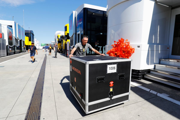 Hungaroring, Budapest, Hungary.  Saturday 29 July 2017. A container of McLaren Honda equipment is pushed through the paddock. World Copyright: Steven Tee/LAT Images  ref: Digital Image _O3I7681