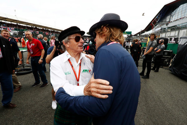 Silverstone, Northamptonshire, UK.  Sunday 16 July 2017. Sir Jackie Stewart and Owen Wilson on the grid. In the background is Astronaut Major Tim Peake. World Copyright: Glenn Dunbar/LAT Images  ref: Digital Image _X4I7295