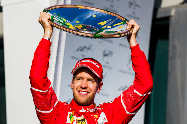Albert Park, Melbourne, Australia. Sunday 26 March 2017. Sebastian Vettel, Ferrari, 1st Position, holds his trophy aloft. World Copyright: Zak Mauger/LAT Images ref: Digital Image _94I2537