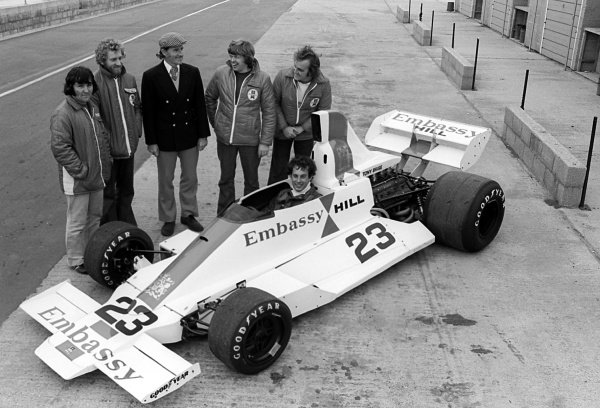 Tony Brise (GBR) sits in the Embassy Hill Racing GH2 for a team photograph including Graham Hill (GBR) Hill Racing Team Owner; Andy Smallman (GBR) Hill Racing Designer and team mechanics. Tragically, just weeks later, Hill, Brise, Smallman and two mechanics were killed in a plane crash at Arkley Golf Course, nr Barnet, on 29 November 1975.