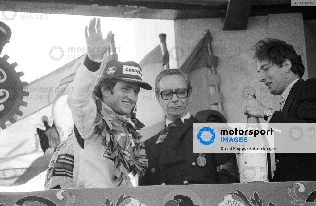 Race winner Patrick Depailler (FRA) Ligier celebrates on the podium.Spanish Grand Prix, Rd 5, Jarama, Spain, 29 April 1979.