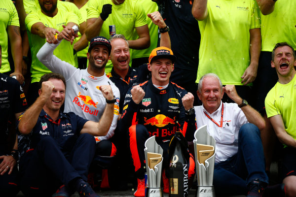 Sepang International Circuit, Sepang, Malaysia. Sunday 1 October 2017. Max Verstappen, Red Bull, 1st Position, Daniel Ricciardo, Red Bull Racing, 3rd Position, Christian Horner, Team Principal, Red Bull Racing, Helmut Markko, Consultant, Red Bull Racing, and the Red Bull team celebrate. World Copyright: Andrew Hone/LAT Images  ref: Digital Image _ONZ0526