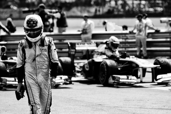 Rubens Barrichello (BRA) Williams in parc ferme. Formula One World Championship, Rd 9, British Grand Prix, Race, Silverstone, England, Sunday 10 July 2011.  Note: This image has been digitally altered from the original, which is also available on the archive. (d11gbr1500.jpg).