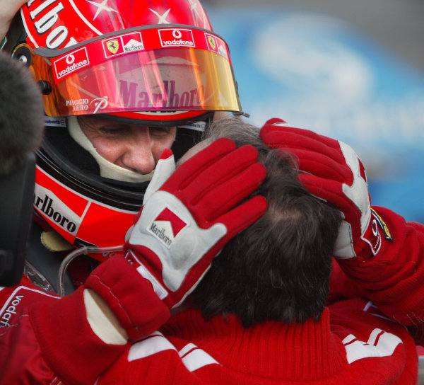2004 Hungarian Grand Prix - Sunday Race,Budapest, Hungary. 15th August 2004 Michael Schumacher, Ferrari F2004 (1st) celebrates clinching the 2004 constructors championship with Jean Todt.World Copyright: Steve Etherington/LAT Photographic ref: Digital Image Only