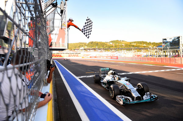 Sochi Autodrom, Sochi, Russia. Sunday 12 October 2014. Lewis Hamilton, Mercedes F1 W05 Hybrid, takes the chequered flag. World Copyright: Steve Etherington/LAT Photographic. ref: Digital Image _RU33457