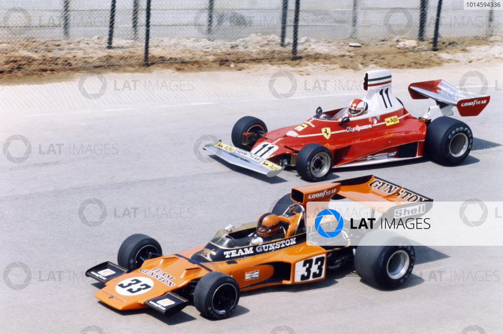 1975 South African Grand Prix. Kyalami, South Africa. 27th February - 1st March 1975. Eddie Keizan (Lotus 72E-Ford), 13th position, leads Clay Regazzoni (Ferrari 312T), 16th position, action. World Copyright: LAT Photographic.