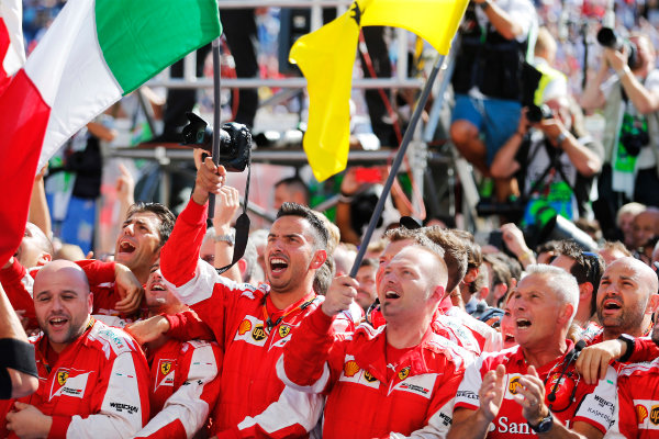 Hungaroring, Budapest, Hungary. Sunday 26 July 2015. The Ferrari team cheer their man on the podium. World Copyright: Steven Tee/LAT Photographic ref: Digital Image _L4R8825