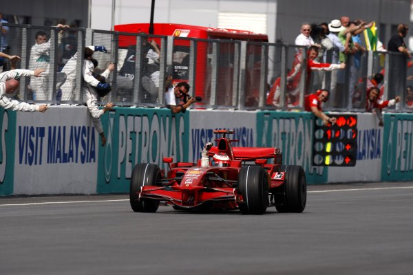 2008 Malaysian Grand Prix - Sunday RaceSepang, Malaysia.23rd March 2008Kimi Raikkonen, Ferrari F2008, 1st position, takes the chequered flag to win the race. Action. Finish.World Copyright: Glenn Dunbar/LAT Photographicref: Digital Image _O9T7734