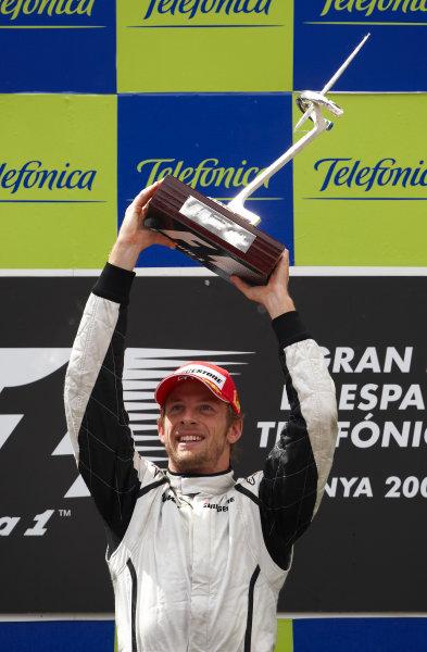 Circuit de Catalunya, Barcelona, Spain 10th May 2009 Jenson Button, Brawn GP BGP001 Mercedes, 1st position, celebrates victory on the podium. Portrait. Podium.  World Copyright: Steve Etherington/LAT Photographic ref: Digital Image SNE13953