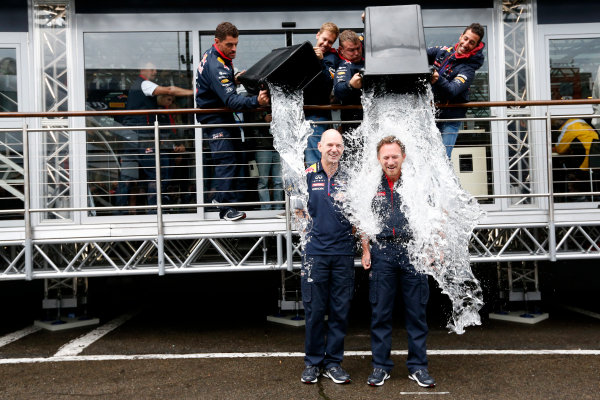 Spa-Francorchamps, Spa, Belgium. Saturday 23 August 2014. Adrian Newey, Chief Technical Officer, Red Bull Racing, and Christian Horner, Team Principal, Red Bull Racing. receive a soaking from Sebastian Vettel, Red Bull Racing, and Daniel Ricciardo, Red Bull Racing, after being nominated for the Ice Bucket Challenge. World Copyright: Alastair Staley/LAT Photographic. ref: Digital Image _R6T4854