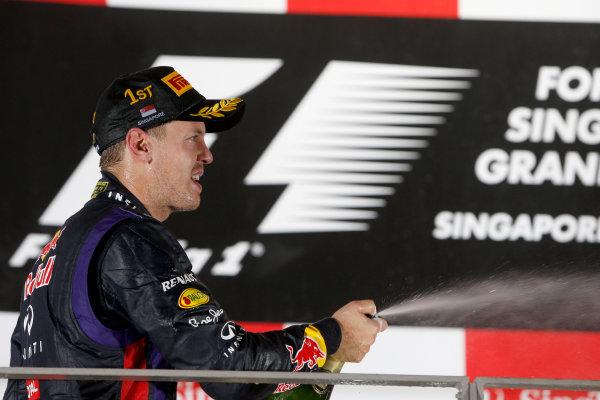 Marina Bay Circuit, Singapore. Sunday 22nd September 2013.  Sebastian Vettel, Red Bull Racing, celebrates on the podium.  World Copyright: Glenn Dunbar/LAT Photographic. ref: Digital Image _89P1380