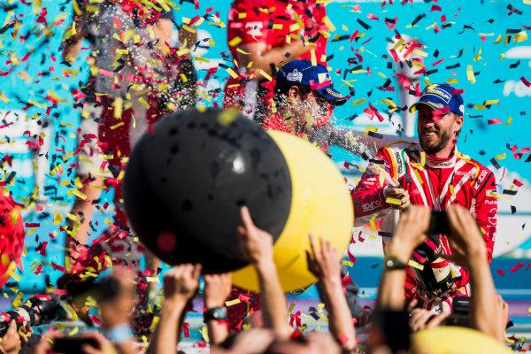 2016/2017 FIA Formula E Championship. Round 7 - Berlin ePrix, Tempelhof Airport, Berlin, Germany. Saturday 10 June 2017. Nick Heidfeld (GER), Mahindra Racing, Spark-Mahindra, Mahindra M3ELECTRO, sprays the champagne on the podium. Photo: Zak Mauger/LAT/Formula E ref: Digital Image _54I7730