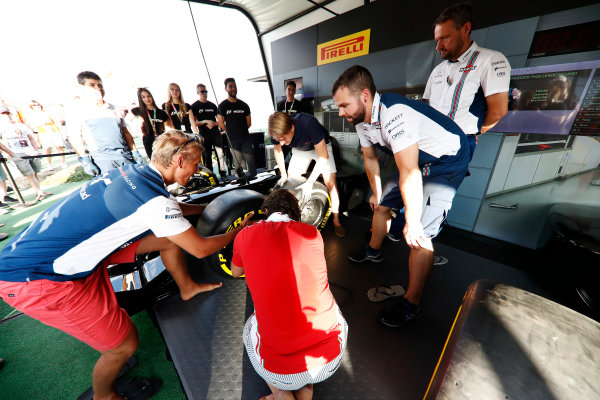 Red Bull Ring, Spielberg, Austria. Saturday 08 July 2017. Fans take part in the Pit Stop Challenge in the F1 fan village. World Copyright: Glenn Dunbar/LAT Images ref: Digital Image _X4I8308