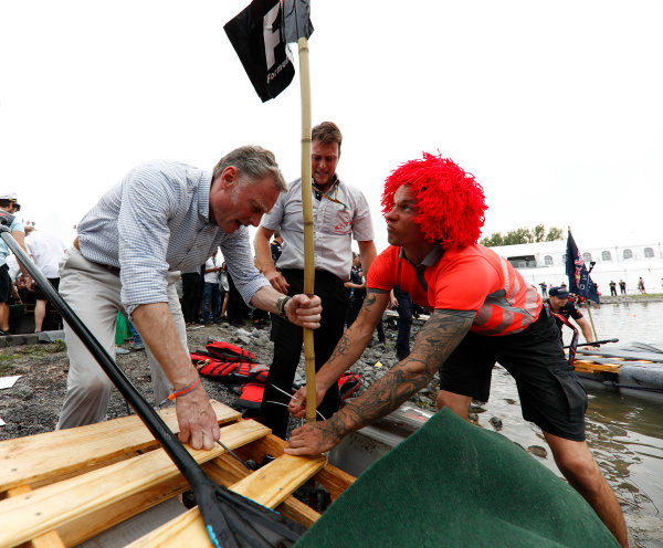 Circuit Gilles Villeneuve, Montreal, Canada. Saturday 10 June 2017. Sean Bratches, Managing Director of Commercial Operations, Formula One Group, raises his flag on the staff of a raft. World Copyright: Glenn Dunbar/LAT Images ref: Digital Image _X4I7124