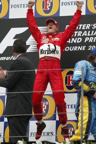 2004 Australian Grand Prix - Sunday Race, Albert Park, Melbourne. Australia. 7th March 2004 Michael Schumacher, Ferrari F2004 celebrates on the podium.World Copyright: Steve Etherington/LAT Photographic ref: Digital Image Only