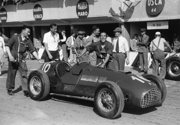 1951 Italian Grand Prix.Monza, Italy. 16 September 1951.Peter Whitehead's Ferrari 125 is pushed in the pits. Ref-51/51 #6A-7.World Copyright - LAT Photographic