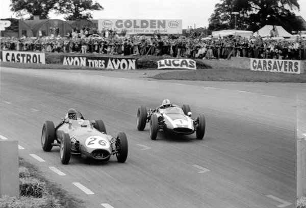 1960 British Grand Prix.Silverstone, Great Britain. 14-16 July 1960.David Piper (#26 Lotus 16-Climax) and Jack Brabham (#1 Cooper T53-Climax). They finished in 12th and 1st position respectively.World Copyright: LAT PhotographicRef: Autosport b&w print