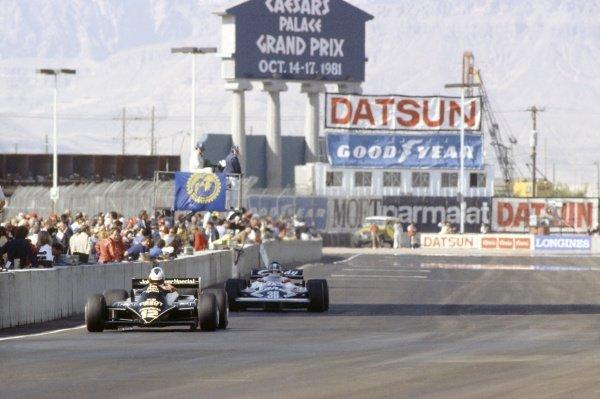 1981 Las Vegas Grand Prix.Caesar's Palace, Las Vegas, Nevada, USA. 15-17 October 1981.Nigel Mansell (Lotus 87-Ford Cosworth), 4th position, leads Derek Warwick (Toleman TG181-Hart) passed the pits.World Copyright: LAT PhotographicRef: 35mm transparency 81LV17