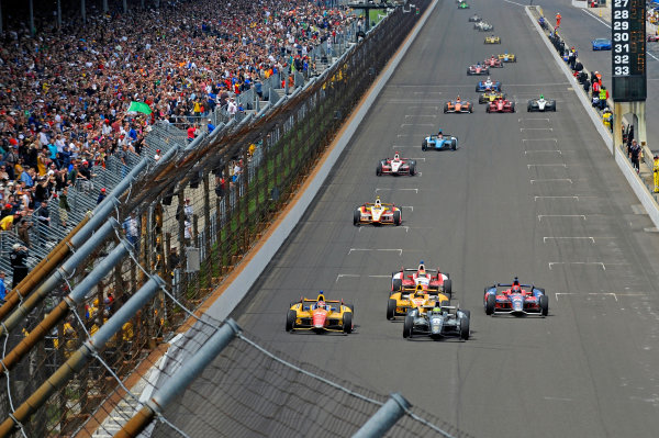 26 May, 2013, Indianapolis, Indiana, USA Eventual winner Tony Kanaan (#11) leads Carlos Munoz (#26), Ryan Hunter-Reay (#1) and Marco Andretti (#25) into turn one to take the lead and the win. ©2013, F. Peirce Williams LAT Photo USA