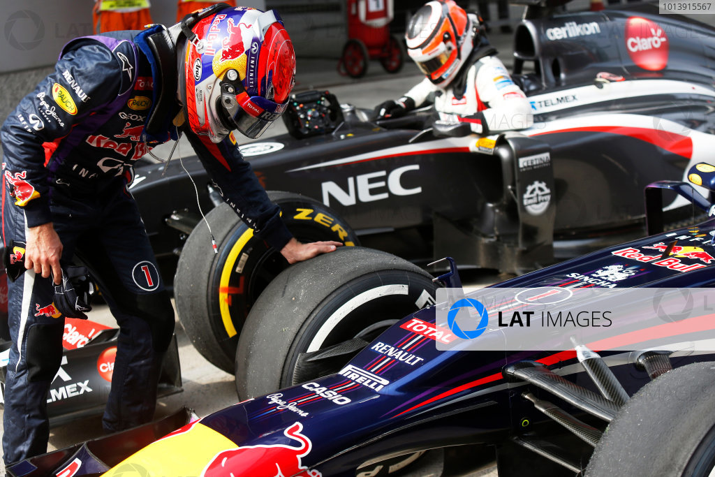 Shanghai International Circuit, Shanghai, China Saturday 13th April 2013 Sebastian Vettel, Red Bull Racing, checks his tyres in Parc Ferme. World Copyright: Charles Coates/LAT Photographic ref: Digital Image _N7T4335