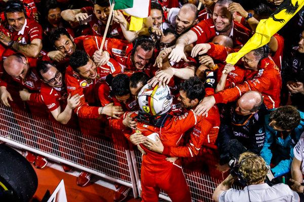 Bahrain International Circuit, Sakhir, Bahrain.  Sunday 16 April 2017. Sebastian Vettel, Ferrari, 1st Position, celebrates with his team in Parc Ferme. World Copyright: Steven Tee/LAT Images ref: Digital Image _R3I0328