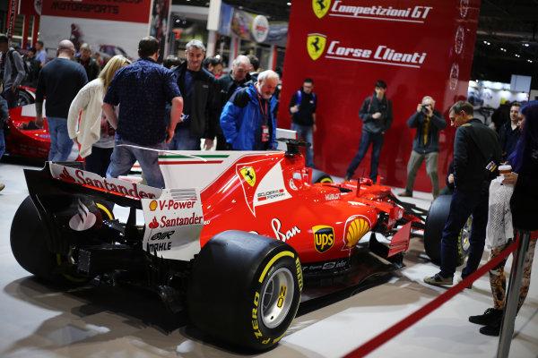 Autosport International Exhibition. National Exhibition Centre, Birmingham, UK. Saturday 13th January 2018. Visitors examine a Ferrari on display.World Copyright: Jakob Ebrey/LAT Images Ref: JR3_3772