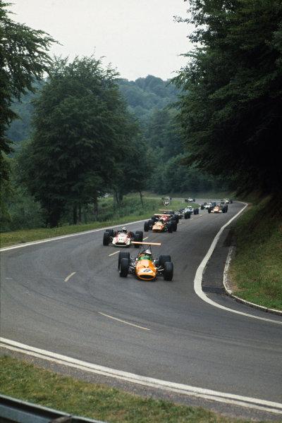 Rouen-les-Essarts, France. 5-7 July 1968.  Denny Hulme (McLaren M7A Ford) leads John Surtees (Honda RA301), Bruce McLaren (McLaren M7A Ford) and the rest of the field.  Ref: 68FRA05. World Copyright - LAT Photographic