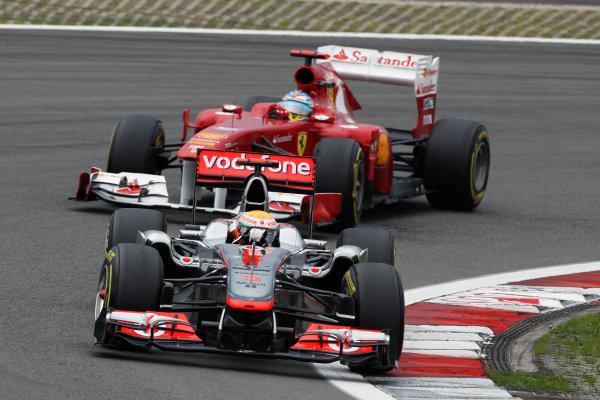 Lewis Hamilton (GBR) McLaren MP4/26 leads Fernando Alonso (ESP) Ferrari 150 Italia. Formula One World Championship, Rd 10, German Grand Prix, Race, Nurburgring, Germany, Sunday 24 July 2011.  BEST IMAGE
