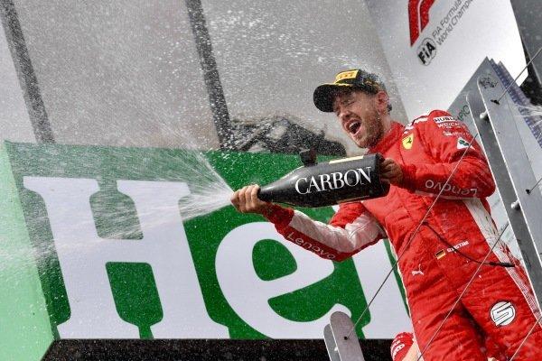 Race winner Sebastian Vettel (GER) Ferrari celebrates with the champagne on the podium