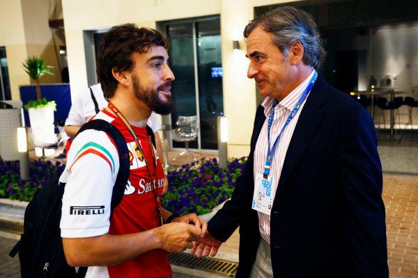 Yas Marina Circuit, Abu Dhabi, United Arab Emirates. Saturday 22 November 2014. Fernando Alonso, Ferrari, with El Matador Carlos Sainz. World Copyright: Andy Hone/LAT Photographic. ref: Digital Image _ONZ1742