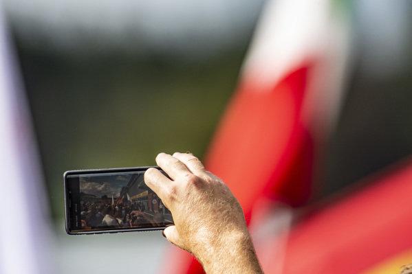 The podium as seen through a phone screen