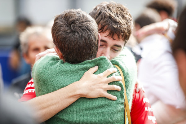 Charles Leclerc, Ferrari, hugs the mother of Anthoine Hubert (FRA, BWT ARDEN)