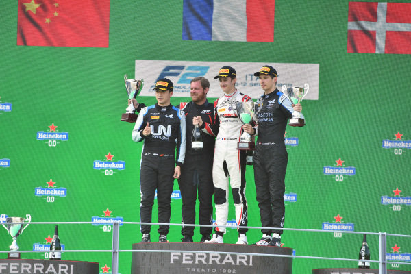 Guanyu Zhou (CHN, Uni-Virtuosi Racing), 2nd position, Theo Pourchaire (FRA, ART Grand Prix), 1st position, and Christian Lundgaard (DNK, ART Grand Prix), 3rd position, on the podium
