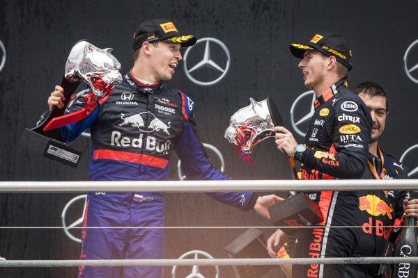 Daniil Kvyat, Toro Rosso and Race winner Max Verstappen, Red Bull Racing celebrate on the podium with the trophy