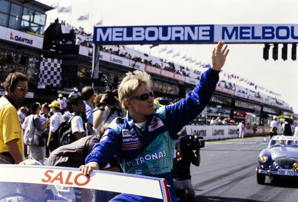 Mika Salo waves to the crowd on the drivers' parade.