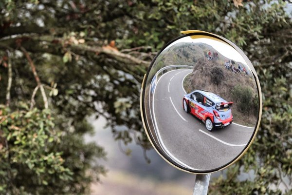 Thierry Neuville (BEL) / Nicolas Gilsoul (BEL) Hyundai i20 WRC reflected in a mirror at FIA World Rally Championship, Rd12, RAAC Rally de Espana, Day Two, Costa Daurada, Catalunya, Spain, 24 October 2015.