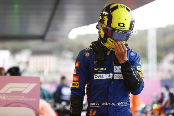 Lando Norris, McLaren, comiserates with himself after the race