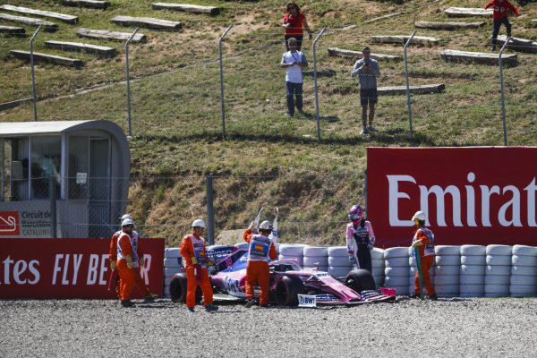 The car of Lance Stroll, Racing Point RP19 bring recovered by marshals